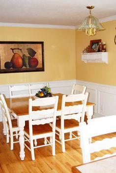 Yellow walls (Behr Warm Muffin), white (faux) wainscotting