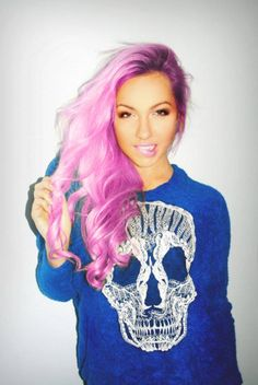 Candy Hair; Light Pink and Fuschia Purple Ombre, Curled Long Hair, Pink Lipstick, Large Skull Graphic on Long Sleeve Crew Neck Shirt.