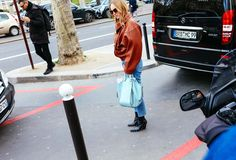 Alexandra Carl in a Loewe jacket and bag, and Céline boots