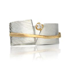 Between You and Me by Dagmara Costello. Hand created sterling silver and 14kt yellow gold ring containing .10ct brilliant cut diamond. Ring is 9mm wide. Available in sizes 4-11.