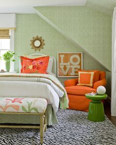 You don't need blue to create a tropical design aesthetic. Use festive colors from the outdoors, like these greens and a floral print. The bold orange chair reminds me of a slice of mango.     Again, notice that bright orange works well paired with green and toned down with neutral colors.