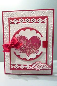 Close To My Heart's Tulip and White Daisy cardstock and ink, A1123 Adore Stamp Set, Cuttlebug embossing folders, CTMH Art Philosophy Cricut Cartridge, and a Gelly Roll glitter pen.