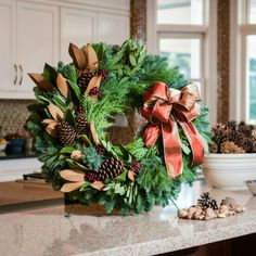 $80 This  gorgeous wreath combines Southern Magnolia leaves, bay leaves, faux berries, white pine, noble fir, cedar, and ponderosa pine cones.