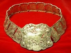 "A Peranakan ladies ""Tali pingang"" or belt made from silver, bronze & somtimes gold..to fasten their sarong."