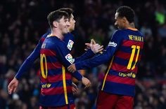 Lionel Messi (L) FC Barcelona celebrates with his teammate Neymar of FC Barcelona after scoring his team's fourth goal during the La Liga match between FC Barcelona and Real Sociedad de Futbol at Camp Nou on November 28, 2015 in Barcelona, Catalonia.
