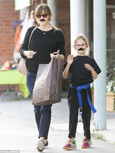 Dress up: Jennifer Garner and Violet, seven, wore fake mustaches when they left a costume store in Los Angeles on Thursday