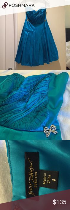 👗Betsey Johnson peacock dress👗 NWOT peacock blue strapless Betsey Johnson evening dress. With rouching and crystal bow detail and pleated skirt. Has 4 layers of slip and tulle skirt(see pic). 100% silk outer & polyester lining with zipper hook closure & rib support. size 8, 33in length, waist 14in. Clean and pet free home! Betsey Johnson Dresses Strapless