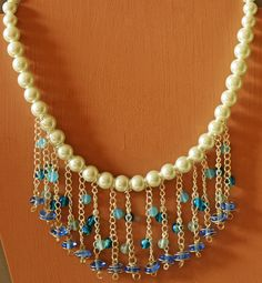 Beautiful faux pearl strands with an addition of color.  Available in other colors as well.  $30.00  http://creationsbyjennilee.com  http://www.facebook.com/CreationsbyJennilee