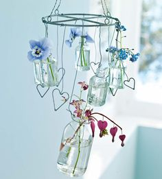 Vase Mobile - almost with the look of a suncatcher - clear (or colored) glass, metal hearts made from wire, the bleeding heart is an especially nice touch - via Ana Rosa