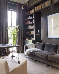 This dark and moody library calls to me. The dark hues get me every time.  That sofa looks so soft and comfy we found a similar style for under $800! http://ift.tt/2EPzoLA @annholdendesign  @pthepaul for @verandamag #CopyCatChic