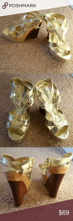 Steve Madden gold strappy wedge sandals Never worn! Gold strappy platform wedge sandals, brown wood and cork heels, 5 inch high with 2 inch platform. Steve Madden Shoes Wedges