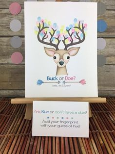 Pink, blue or dont have a clue? This is a great way to commemorate all the guests at a gender reveal party with a woodland theme! Have guests add their fingerprints in pink or blue (even green!) and sign their names to decorate the buck's antlers—Then you can frame it for a keepsake! This