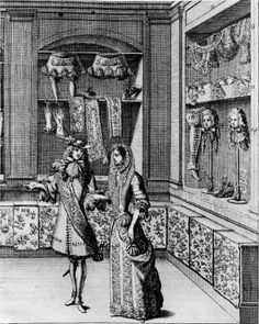 "Interior of a Parisian milliner's shop: March 1678, ""On display are accessories to men's fashionable costume—breeches, scarves, gloves, and wigs,"" detail from an engraving by J. Lepautre after J. Bérain, re-engraved from a small print in the ""Extraordinaire"" issue of the ""Mercure Galant."""