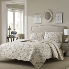 Soft, nature-like shades of taupe, blue and ivory give this serene Stone Cottage Zen Garden quilt set an elegant look. The quilt and sham set reverses to a dotted stripe design for two looks in one.
