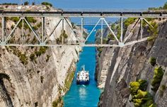A boat crossing the Corinth Canal © Alexander Tolstykh / Shutterstock Mykonos, Santorini, Corinth Canal, Village Hotel, Destinations, Visual And Performing Arts, Voyage Europe, Small Island, Lonely Planet