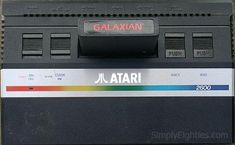 New style 1984 version of the Atari 2600 with Galaxian cartridge