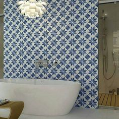 Really cool patterned tile wall for the bathroom.