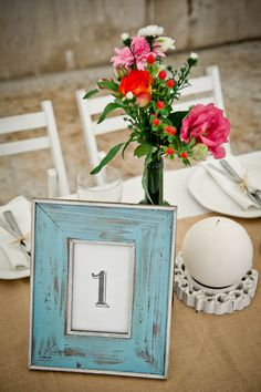 Love the frame used here. If you have a chance, check out all the photos of this wedding, no two tables were alike, very charming.