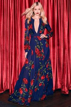 Lulus Exclusive! Galas and garden parties give you the perfect excuse to show off the Blossom Buddy Red and Navy Blue Floral Print Maxi Dress! Red floral print blooms across navy blue woven poly as it shapes a plunging V-neck (with three modesty clasps), and sheer long sleeves with button cuffs. Seamed bodice meets a banded waist, and maxi skirt. Hidden back zipper/clasp.