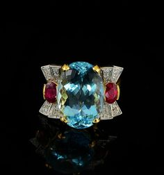 Retro ca. 1940/50. Hand crafted of solid 18 Kt gold - marked.  15.50 ct. (est.) natural medium light sky blue oval cut aquamarine flanked by 2 natural oval cut rubies  - estimated weight 1.40 Ct each.  $4, 469.70