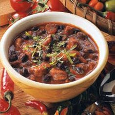 In Dutch oven, brown pork in oil; drain. Add onions; cook & stir for 3 min. Add garlic; cook 1 min. Stir in broth, tomatoes & seasonings. Bring to boil. Reduce heat; simmer, uncovered, for 1 hr. or until meat is tender, stirring several times. Skim fat; stir in beans. Simmer 15-30 min. longer or until chili reaches desired thickness. Garnish with cilantro if desired.