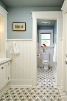 Wainscoting in the guest bathroom? // Craftsman wainscoting and tile bathroom with blue walls Upstairs Bathrooms, Downstairs Bathroom, Bathroom Renos, Laundry In Bathroom, Bathroom Beadboard, Tile Bathrooms, Bathroom Moulding, Modern Bathroom, Bathroom Ideas