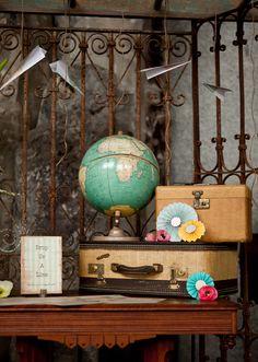 Vintage travel decor: vintage globes and suitcases.