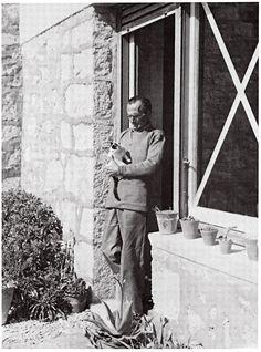 Nikos Kazantzakis at his house in Aegina with his cat Sminthitsa. March 1943.