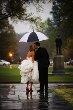 I would actually love to have a rainy wedding day. To have the smell and the glittering pavement,and you don't have to spend the whole entire time outside. Though running through the rain would be fun!