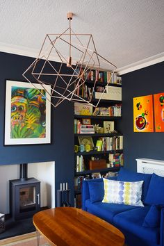 Cosy Lounge With Dark Walls, Wood Burner, Floating Shelves and Colourful Art Victorian Living Room, Edwardian House, Victorian Terrace, Log Burner Living Room, Dark Living Rooms, Cast Iron Fireplace, House And Home Magazine, Interiores Design, Home Interior Design