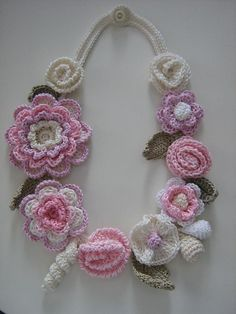 Long necklace made in crochet. Crochet hearts and wooden beads as ornamental motifs. All my creations are one of a kind. Crochet Puff Flower, Crochet Flower Patterns, Love Crochet, Irish Crochet, Beautiful Crochet, Crochet Flowers, Crochet Lace, Crochet Crafts, Crochet Projects