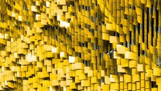 panels of an interactive wall sculpture of a parking structure by rob ley.