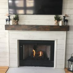 Custom shiplap fireplace from Blue Dog Design in Ortonville, MI