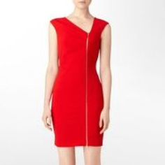 RED CALVIN KLEIN ZIPPER DRESS Stunning red dress with gold zipper up the front. Wear it unzipped at the bottom to show a little leg, unzip it a bit at the top, or wear it fully zipped at the office. More pics to come Calvin Klein Dresses