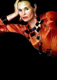 Gloria Vanderbilt as a model wearing a Fortuny Delphos dress in stunning jewels of Rita Delisi