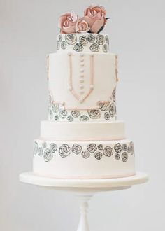 Rosalind Miller art deco pink and black 1920s roses print wedding cake. Please don't call it Gatsby. Read the book. It is anti-over-the-top parties. See the irony in a Gatsby themed wedding? *gets down from soapbox*