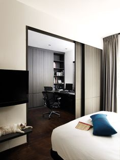 Sliding doors separate the study and walk-in wardrobe space from the bedroom
