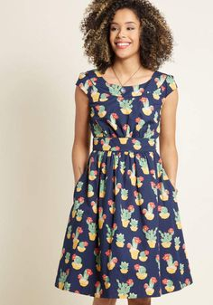 bdae2a73be This pocketed dress by hard-to-find British brand Emily and Fin will lift  your spirits when you need it! Finessed with a boat neckline, a ruched  bodice, ...