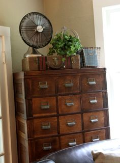 use a vintage suitcase to store paper?