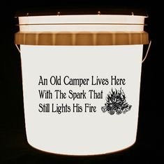 his bucket light features a roaring campfire and the words An Old Camper Lives Here With The Spark That Still Lights His Fire.     We can customize this bucket light with your own combination of words and/or images.