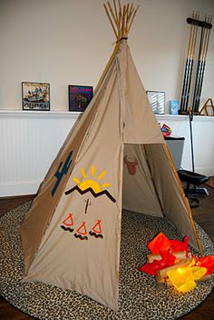 We decided to make a teepee for the kids. It is made out of bamboo rods, 1 king size sheet (cut very strategically), and hot glue. No teep. Art For Kids, Crafts For Kids, American Day, Diy Teepee, Dramatic Play Area, Native American Crafts, Indian Crafts, Le Far West, Thanksgiving Crafts