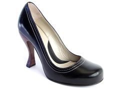 """""""...timeless rounded toe with tunite (what is that ???) sole and a sensible and elegant 4"""" curvy leather wrapped heel complete with a small platform for comfort ..."""""""