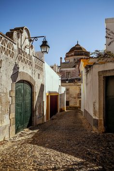 A view of Évora, the capital, where a first-century Roman temple, a medieval convent, and opulent 16th-century facades stand shoulder to shoulder along narrow cobbled streets.
