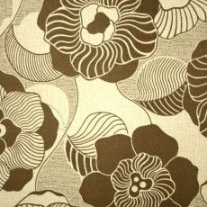 Brown floral wallpaper with large flower pattern on a beige textured background.