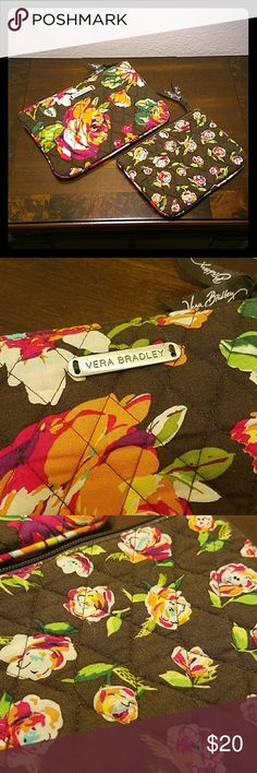 Vera Bradley - Set of 2 Cosmetic Bags! Set of 2 Vera Bradley cosmetic bags! The inside of the larger one has minor make up stains, but no holes or rips. Smaller one has no stains. Outside of both are in like new condition! Vera Bradley Bags Cosmetic Bags & Cases