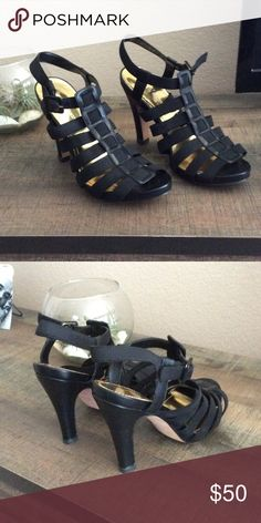 """Vince Camuto strappy black heels Stretchy black straps with leather detailing, buckle at the ankle. 4"""" heel. Like new. Very comfortable for a sexy shoe! Shoes Heels"""