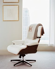 """The iconic Eames Lounge Chair, pictured here,   Im looking at the monogrammed THROW - loving the letter """" H """"."""