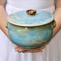 wheel thrown ceramic casserole dish w/ Birds Nest lid.  dishwasher/oven/microwave safe...and so beautiful.  I love her pieces.  I want this!