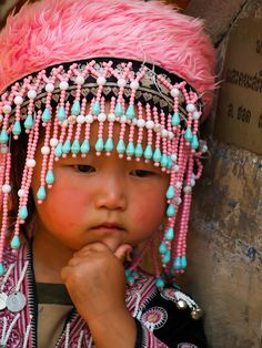 A little woman being very pretty and pensive - China. See more: www.UnhookNow.blogspot.com