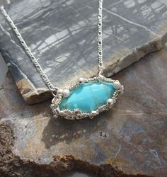 Sterling Silver WIre Wrapped Turquoise Necklace. $42.00, via Etsy.